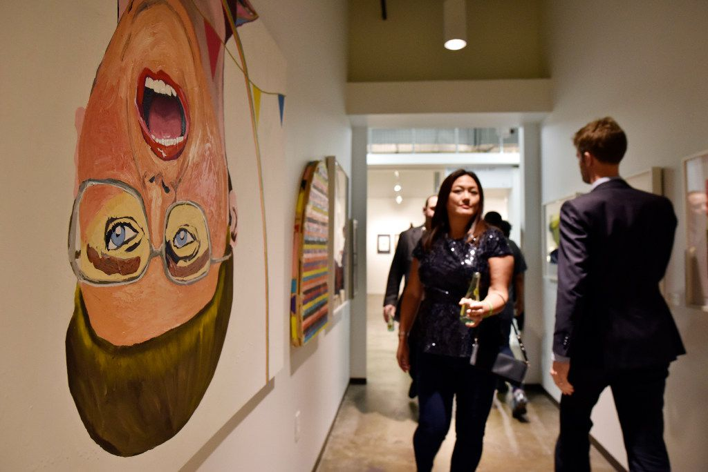 Mixed media on canvas, left, titled Sometimes a Woman isn't a Woman, 2013, by Alexander Paulus, during the Preview Gala of ninth annual Dallas Art Fair, April 6, 2017 at the Fashion Industry Gallery in Dallas. (Ben Torres/Special Contributor)