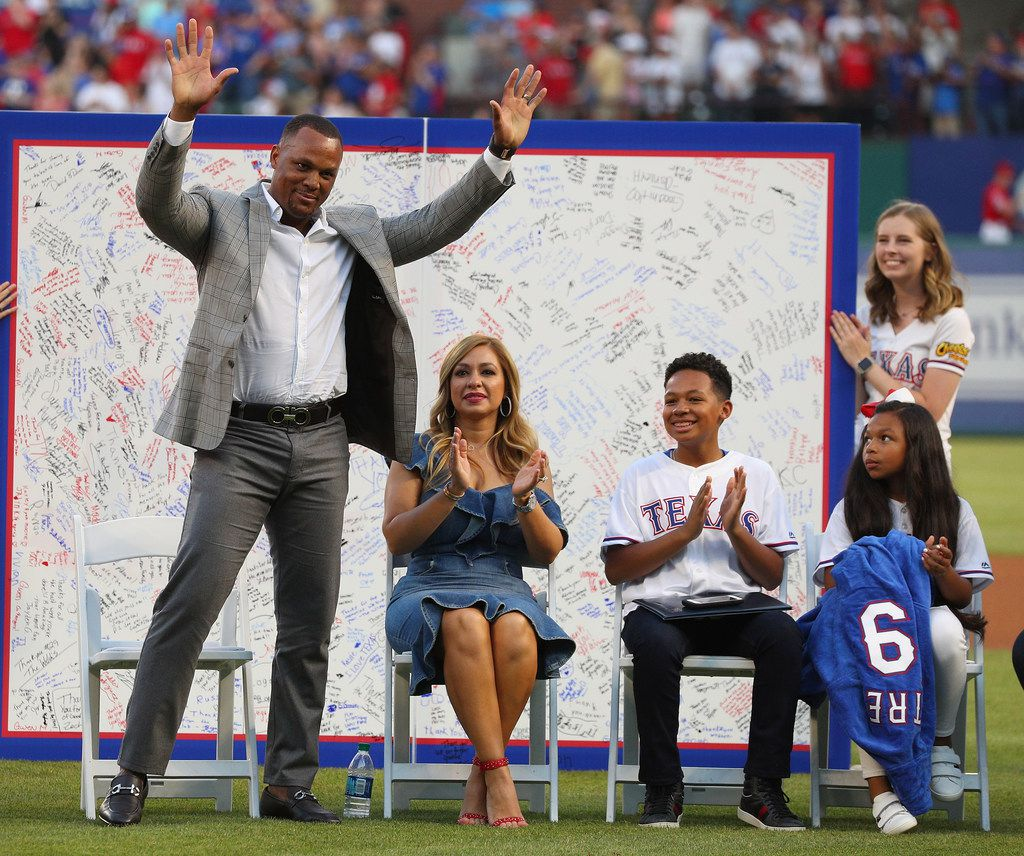 ARLINGTON, TEXAS - JUNE 08: Former Texas Ranger's third baseman Adrian Beltre waves to the crowd as his wife Sandra and children Adrian Jr and Canila look on at a ceremony to retire his jersey #29 at Globe Life Park in Arlington on June 8, 2019 in Arlington, Texas. (Photo by Richard Rodriguez/Getty Images)