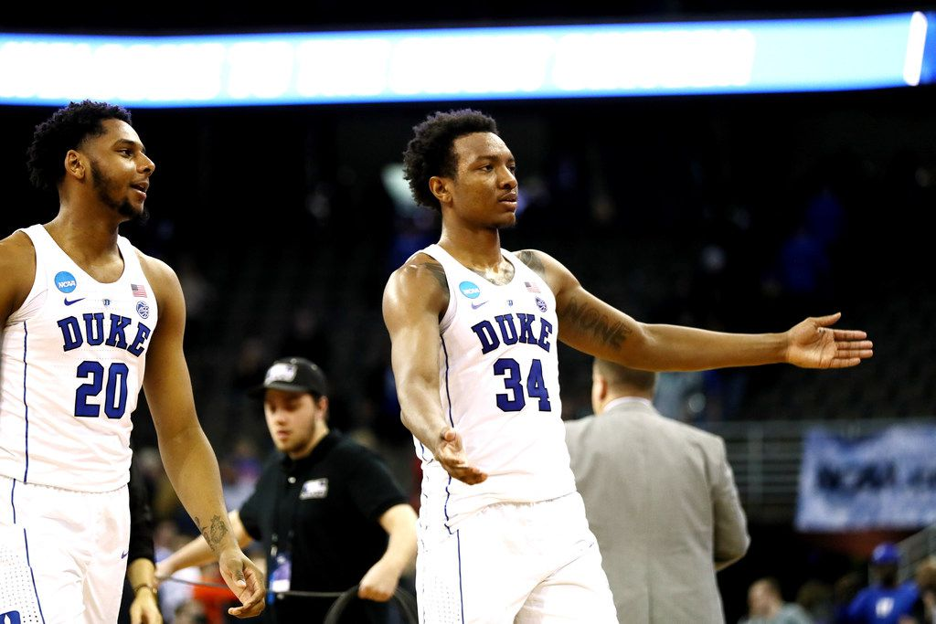 OMAHA, NE - MARCH 23: Marques Bolden #20 and Wendell Carter Jr #34 of the Duke Blue Devils celebrate their teams win over the Syracuse Orange during the second half in the 2018 NCAA Men's Basketball Tournament Midwest Regional at CenturyLink Center on March 23, 2018 in Omaha, Nebraska. The Duke Blue Devils defeated the Syracuse Orange 69-65.  (Photo by Jamie Squire/Getty Images)