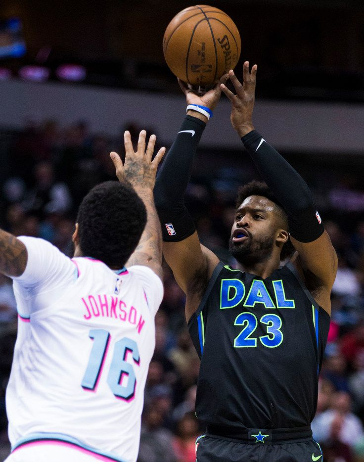 Dallas Mavericks guard Wesley Matthews (23) goes up for a shot over Miami Heat forward James Johnson (16) during the first quarter of an NBA game between the Dallas Mavericks and the Miami Heat on Monday, January 29, 2018 at American Airlines Center in Dallas. (Ashley Landis/The Dallas Morning News)
