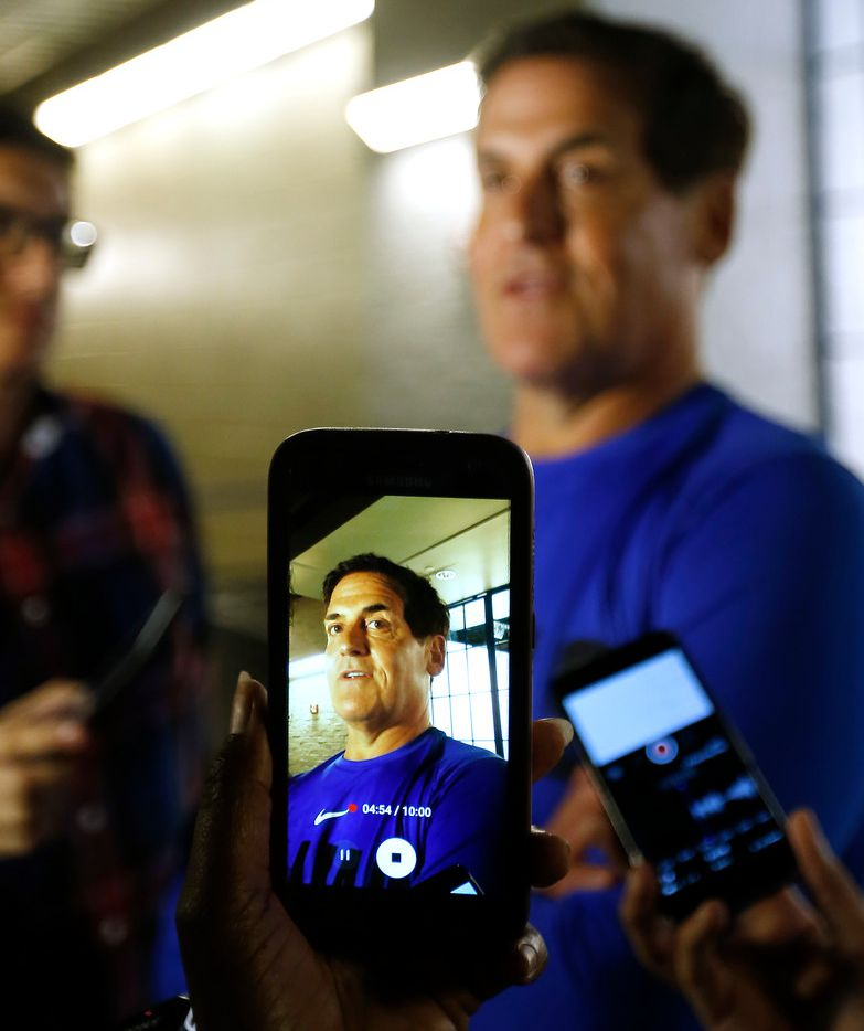 A member of the media uses a cell phone to record a video of Mark Cuban in an interview during the media day at American Airlines Center in Dallas, Monday, Sept. 25, 2017. (Jae S. Lee/The Dallas Morning News)