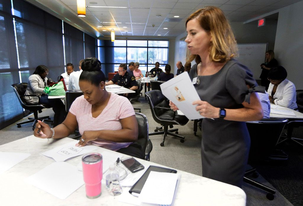 Jennifer Zientz (right) explains a task to Dallas police Officer Jennifer Wells during a training session at the UT Dallas Center for BrainHealth.