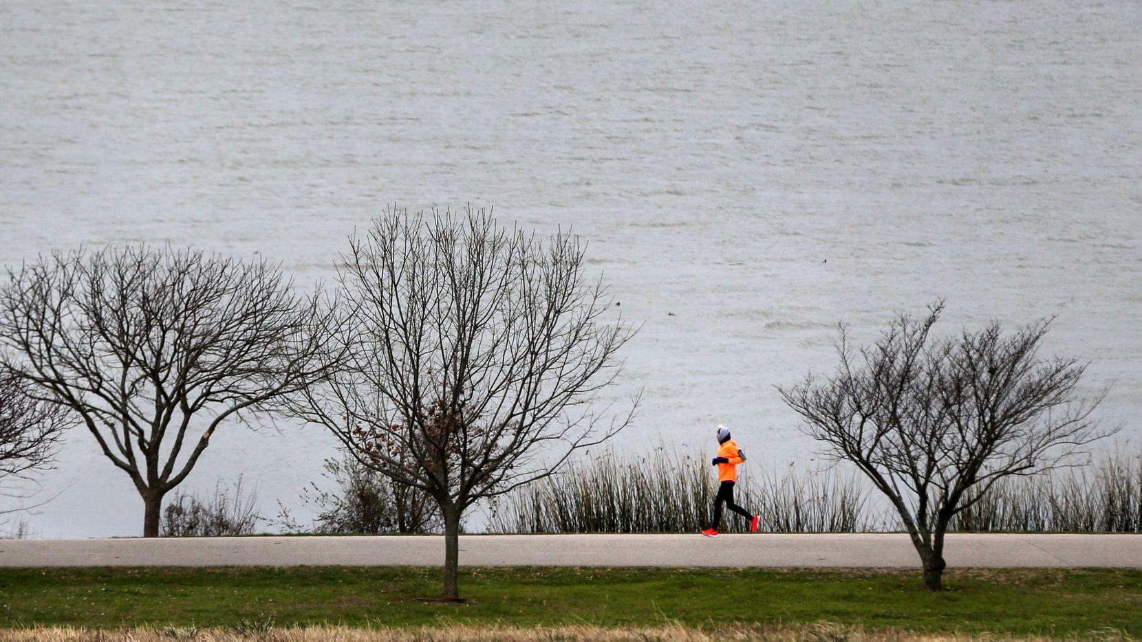 Susan Tiner ran in 24-degree weather at White Rock Lake in Dallas on Monday morning.