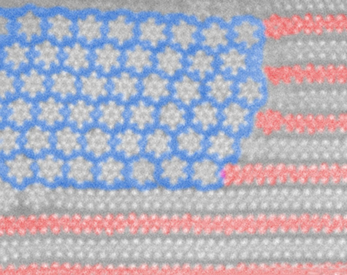 """This microscopic nanoflag pattern emerged as sheets of the """"stripe"""" material -- molybdenum ditelluride -- were heated to about 450 degrees Celsius, at which point its atoms began to rearrange and form new structures -- the """"stars."""" Researchers added colors to enhance the image. (Courtesy UT-Dallas"""