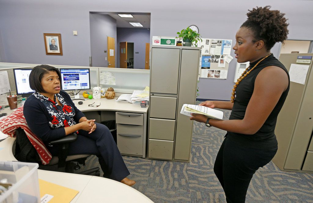 Program Director Marion Appiah (right) talks with caseworker Sherri Thompson in the office of Dallas Police Department's First Offender Program at DPD headquarters.