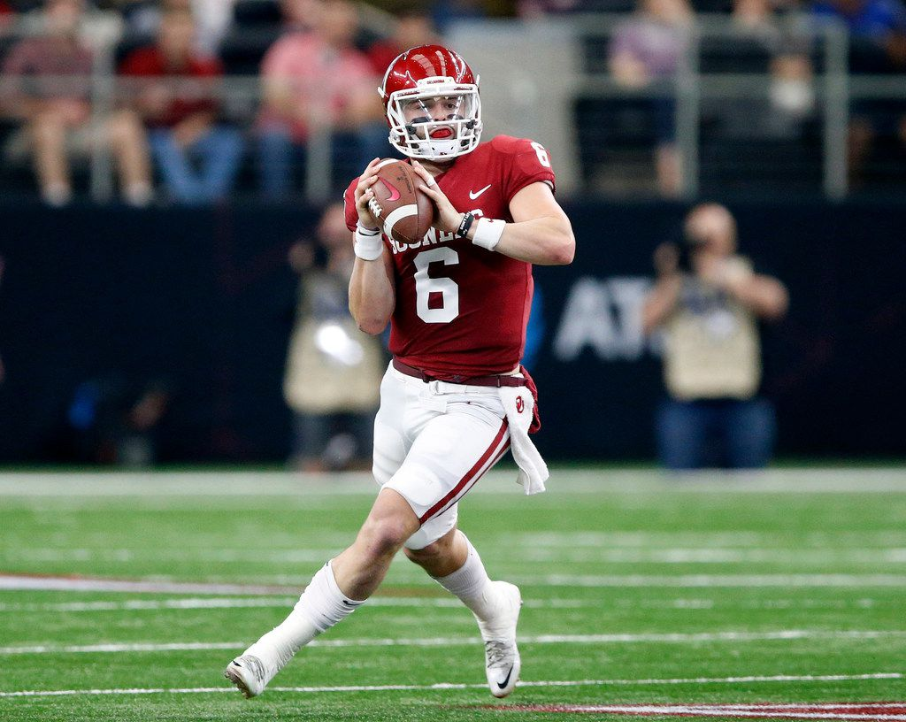 FILE - Oklahoma quarterback Baker Mayfield (6) rolls out to pass during the second quarter of the Big 12 championship game against TCU at AT&T Stadium in Arlington on Saturday, Dec. 2, 2017. (Tom Fox/The Dallas Morning News)