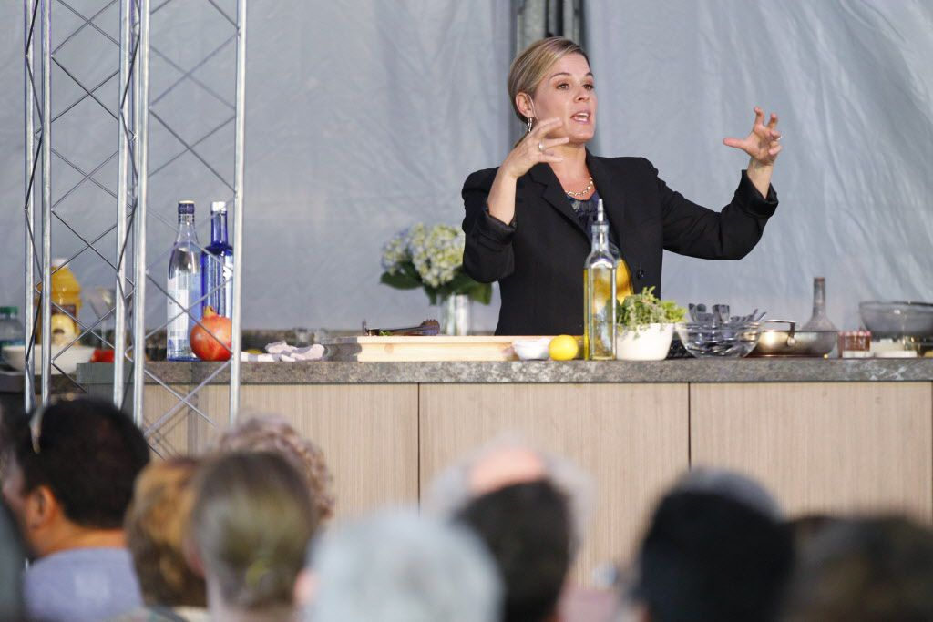 Iron chef Cat Cora demonstrates a cooking class during the Fork & Cork festival Addison Circle Park in Addison, TX on May 15, 2015.