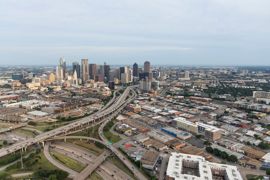 A view looking from south to the north of downtown Dallas. Shown are I-30 (foreground, bottom left, running left to right) and Highway 345 (running from bottom left to top center, south to north) in Dallas on Friday, June 14, 2019. The Coalition for a New Dallas wants to tear down the highway and replace it with a mixed-income, mixed-use neighborhood.
