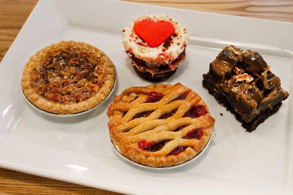 The pecan pie, cherry pie, red velvet cake and chocolate chunk caramel brownie at Hickory Bird.