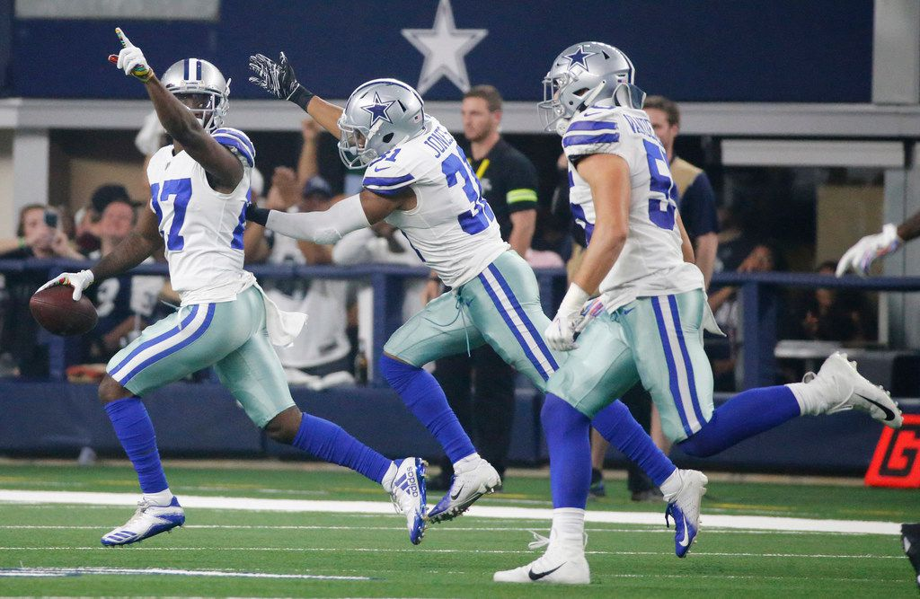 Dallas Cowboys cornerback Jourdan Lewis (27) celebrates recovering a fumble with teammates during the Jacksonville Jaguars vs. the Dallas Cowboys NFL football game at AT&T Stadium in Arlington, Texas on Sunday, October 14, 2018. (Louis DeLuca/The Dallas Morning News)