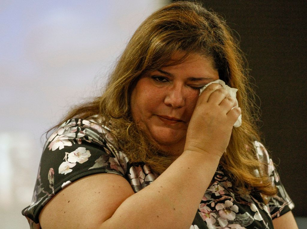 Linda Randazzo wipes away tears after speaking to the leadership group a Medical City Plano about her experience during Sept. 11, 2001 in Plano, Texas, Wednesday, Sept. 11, 2019. Randazzo was on the 35th Floor of One World Trade Center when planes crashed into the building.