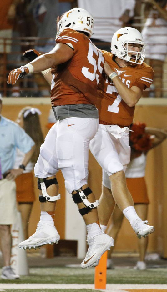 Texas quarterback Shane Buechele (7) celebrates a fourth quarter touchdown with offensive lineman Connor Williams (55) during the Notre Dame Fighting Irish vs. the University of Texas Longhorns NCAA football game at Darrell K. Royal Memorial Stadium in Austin on Sunday, September 4, 2016. (Louis DeLuca/The Dallas Morning News)