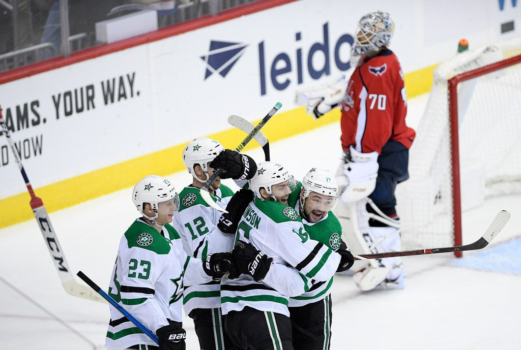 Dallas Stars center Jason Dickinson (16) celebrates his game-winning goal with center Devin Shore (17), center Radek Faksa (12), and defenseman Esa Lindell (23), of Finland, in the overtime of an NHL hockey game as Washington Capitals goaltender Braden Holtby (70) skates away, Saturday, Nov. 3, 2018, in Washington. The Stars won 4-3 in overtime. (AP Photo/Nick Wass)
