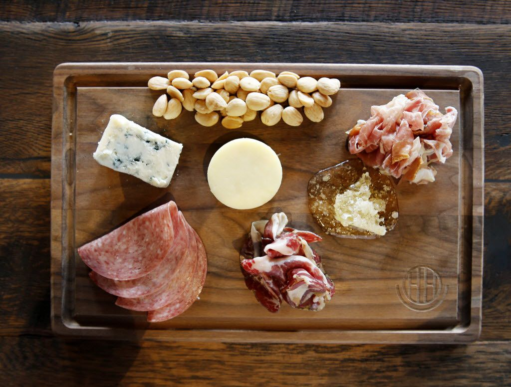 Happiest Hour's charcuterie board with rotating meats and cheese from around the world at the Happiest Hour in Dallas on Thursday, October 8, 2015.