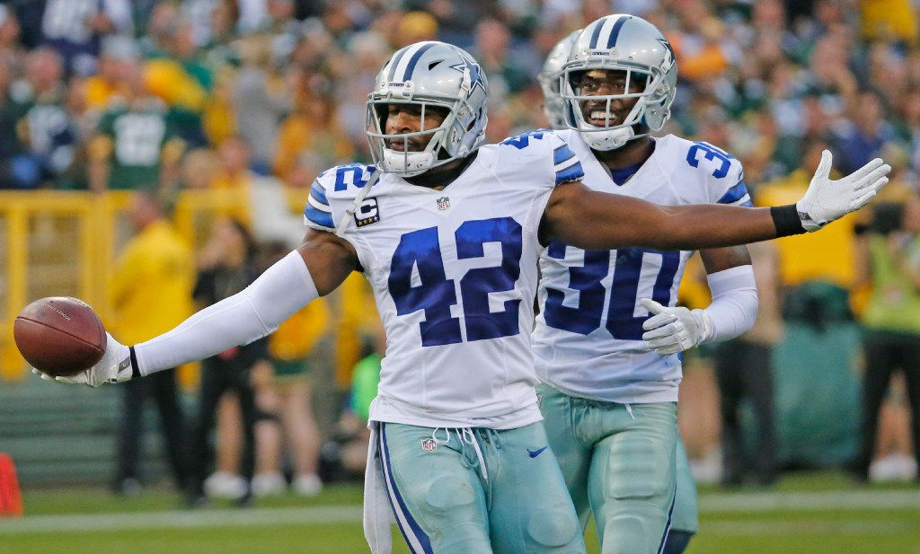 Dallas Cowboys strong safety Barry Church (42) celebrates his interception with teammate Anthony Brown (30) during the Dallas Cowboys vs. the Green Bay Packers NFL football game at Lambeau Field in Green Bay, Wisconsin, on Sunday, October 16, 2016. (Louis DeLuca/The Dallas Morning News)