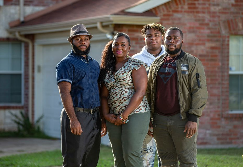 Sammie Anderson (second from left) filed a police brutality complaint with DeSoto police in August. Her sons are Sam Bible (left), 18, Tyrone Anderson (third from left), 15, and Grant Bible, 20.