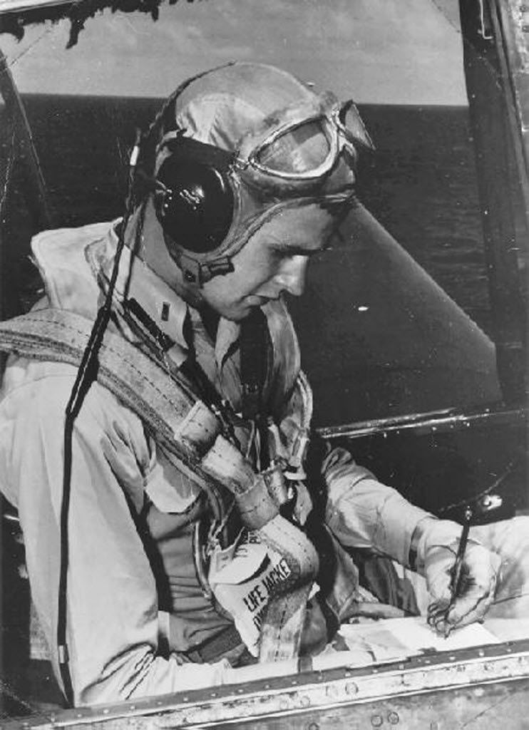 Navy pilot George H.W. Bush sits in the cockpit of an Avenger fighter aircraft, c. 1943-45.