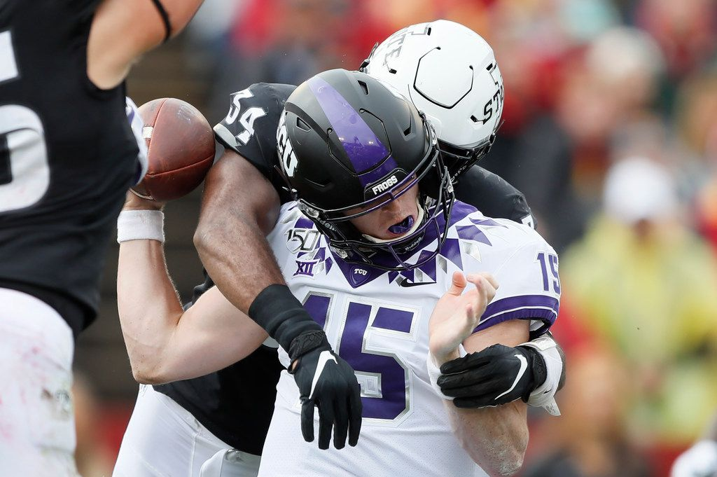 TCU quarterback Max Duggan fumbles as he is hit by Iowa State linebacker O'Rien Vance (34) during the first half of an NCAA college football game, Saturday, Oct. 5, 2019, in Ames, Iowa. (AP Photo/Charlie Neibergall)