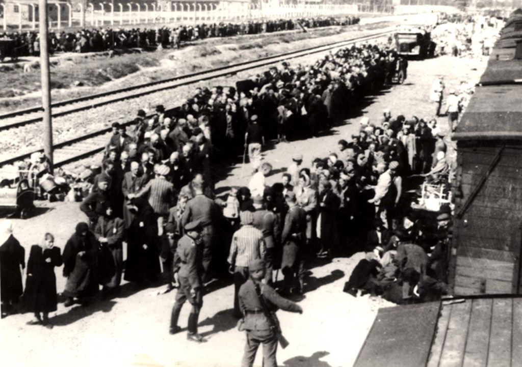 "Many residents of the German village of Kippenheim were ultimately sent to their deaths at the Auschwitz concentration camp in Poland. This photograph shows prisoners arriving at the Nazi camp in 1943 and being sent to either ""the right or the left"" — one direction meaning their life, as it were, would continue, the other direction meaning certain death."