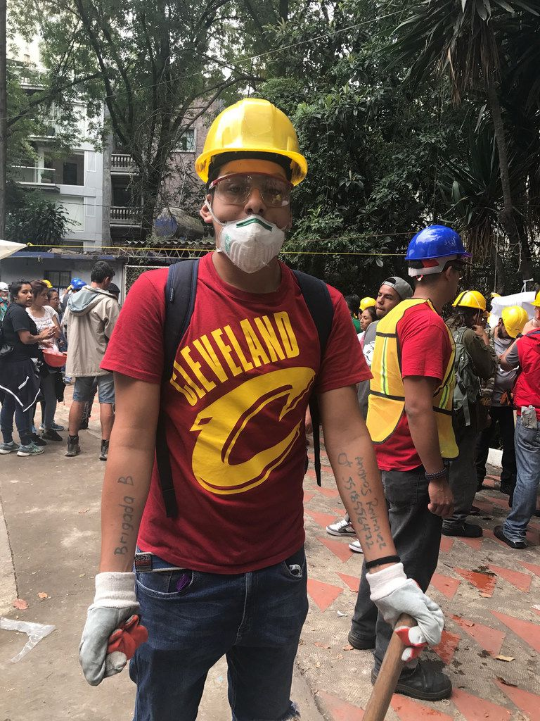 Andres Gustavo Rodriguez, 16, is one of the many volunteers. He became a member of a brigade and went to check on buildings on the verge of collapsing and look for victims.