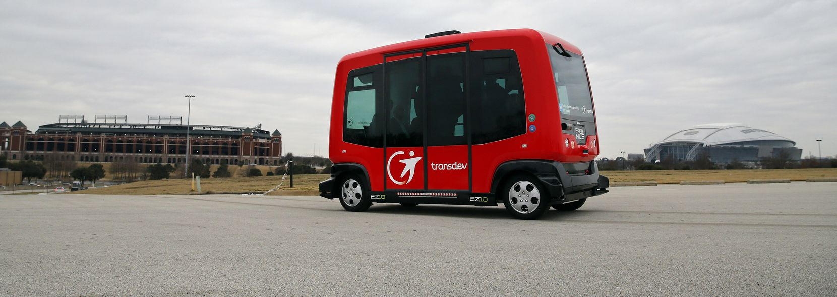 """Alliance for Transportation Innovation's  EZ-10, a six-seat self-driving shuttle ferries passengers from a set location on a closed course near the Globe Life Park in Arlington, Arlington is gaining popularity as a testing ground for self-driving cars. Last week, the Department of Transportation named it a """"national Automated Vehicle Proving Ground."""" (File photo)"""