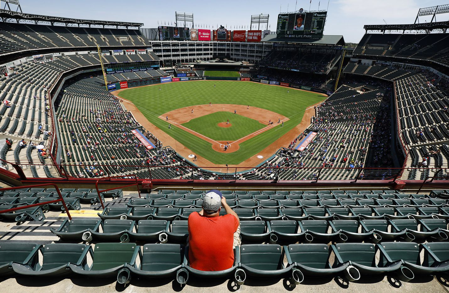 A lone baseball fan, who wished not to provide his name, had several sections of seats in the sun to choose from during the Texas Rangers-Cleveland Indians game at Globe Life Park in Arlington, Texas, Sunday, July 22, 2018.