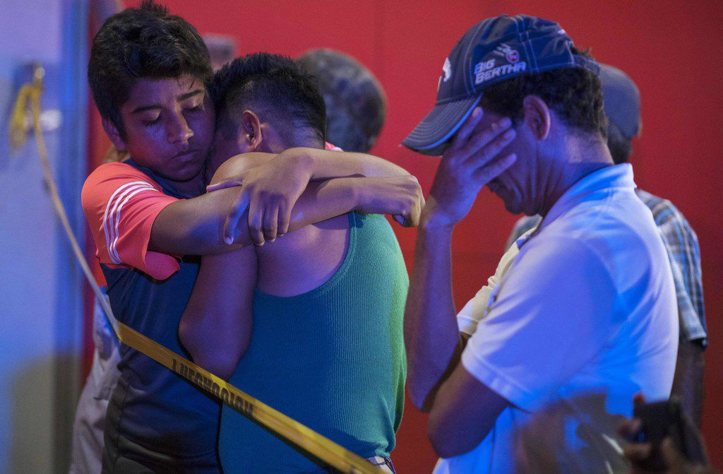 People react outside a bar where 23 people were killed by a fire in Coatzacoalcos, Veracruz, Mexico, on Aug. 28, 2019. At least 23 people were killed and 13 badly wounded in a fire at Caballo Blanco bar.