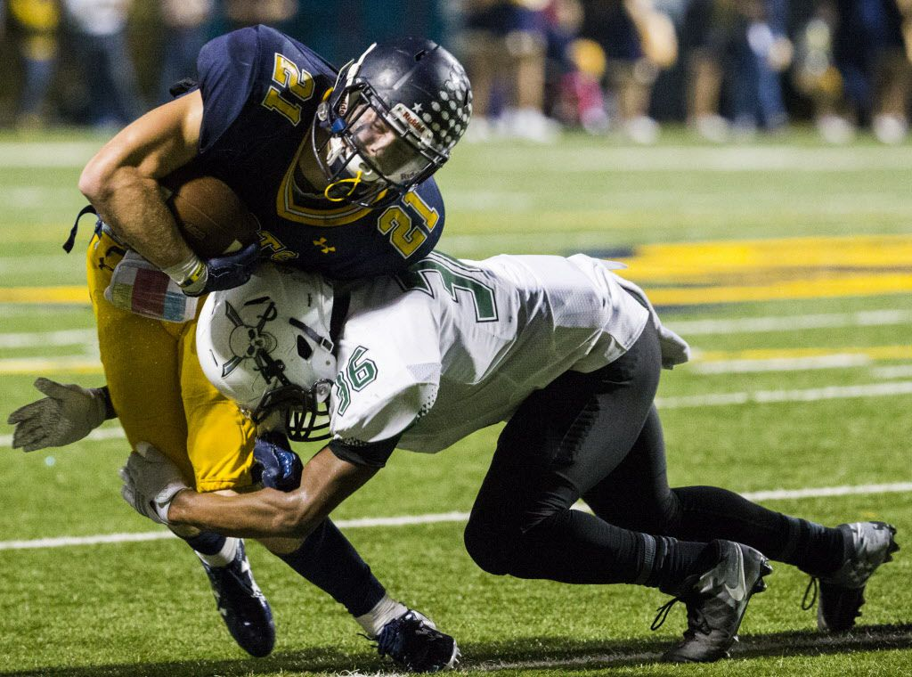 Highland Park running back Jack Kozmetsky (21) is tackled by Mesquite Poteet linebacker Byron Law II (36) during the second quarter of their game on Friday, October 14, 2016 at Highlander Stadium in Highland Park, Texas. (Ashley Landis/The Dallas Morning News)