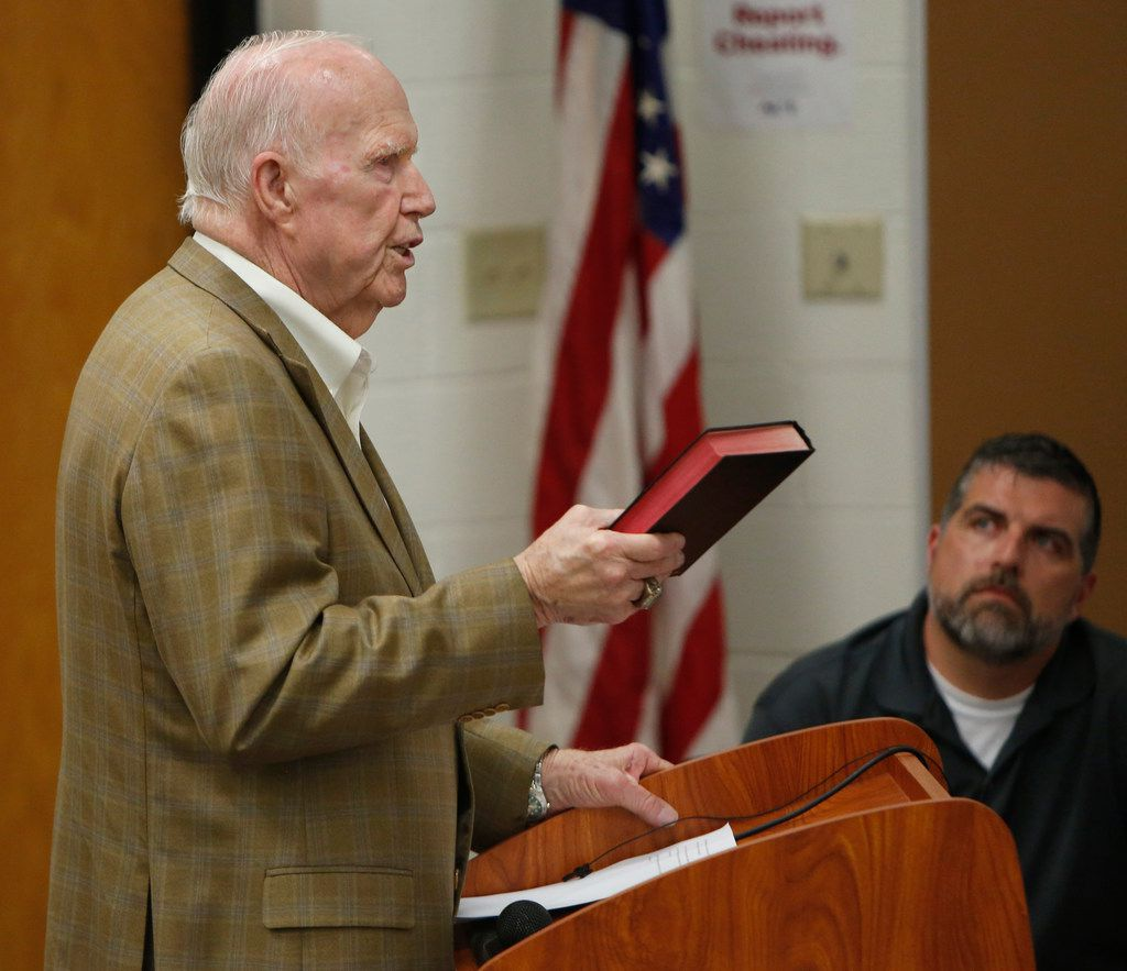 Gale Galloway, former Chairman of the Board of Regents at Baylor University, brandishes a bible as he speaks favorably of the hiring of Art Briles as School Board member John Gann listens.The meeting of the Mount Vernon ISD Board was the first since naming Art Briles as its head football coach. The Meeting was held in the High School Lecture Hall in Mount Vernon on June, 17, 2019.  (Steve Hamm/ Special Contributor)