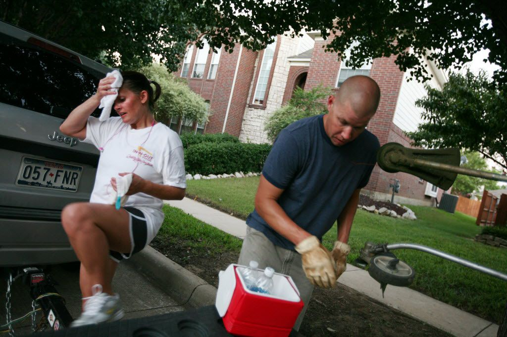 Marie Heil wipes away sweat as her husband, Aaron, gets water after the pair mowed a client's yard in Fort Worth in 2010. At the time, Aaron taught in Southlake and Marie, in Keller. They mowed lawns for extra money. A new survey shows nearly one-third of Texas teachers moonlight.