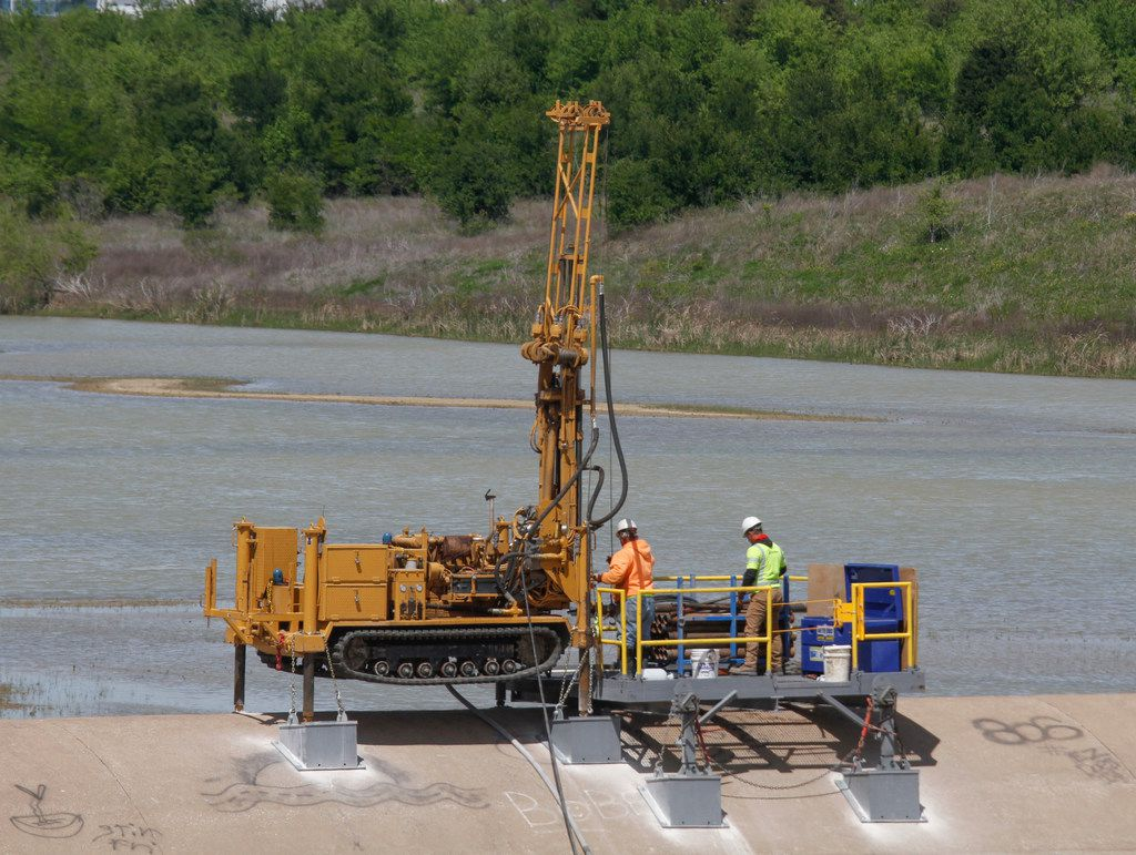 Independent contractors were drilling and testing to see how many new anchors are needed and how strong they need to be for the stability of the spillway at the Lewisville Lake dam in Lewisville, Texas on Thursday, April 19, 2018. The Lewisville dam is currently functioning as designed according to the U.S. Army Corps of Engineers.