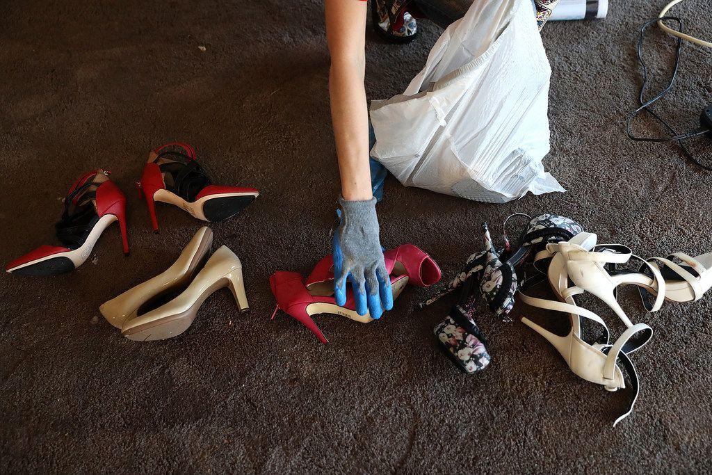 RICHWOOD, TX - SEPTEMBER 07:  Jamie Praslicka sorts through shoes in her flood damaged home on September 7, 2017 in Richwood, Texas. Over a week after Hurricane Harvey hit Southern Texas, residents are beginning the long process of recovering from the storm.  (Photo by Justin Sullivan/Getty Images)