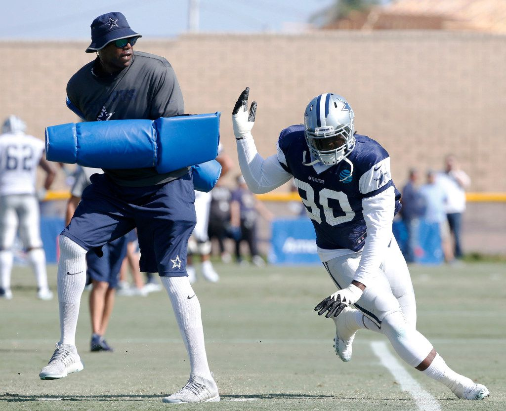 Dallas Cowboys defensive end Demarcus Lawrence (90) works with Dallas Cowboys Leon Lett in a drill during training camp in Oxnard, California on Wednesday, August 9, 2017. (Vernon Bryant/The Dallas Morning News)