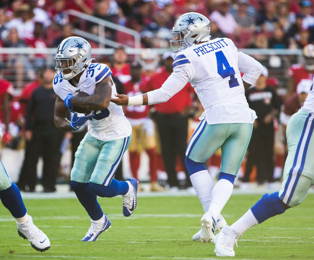 Dallas Cowboys quarterback Dak Prescott (4) hands off the ball to running back Tony Pollard (36) of an NFL preseason game between the Dallas Cowboys and the San Francisco 49ers on Saturday, August 10, 2019 at Levi's Stadium in Santa Clara, California. (Ashley Landis/The Dallas Morning News)