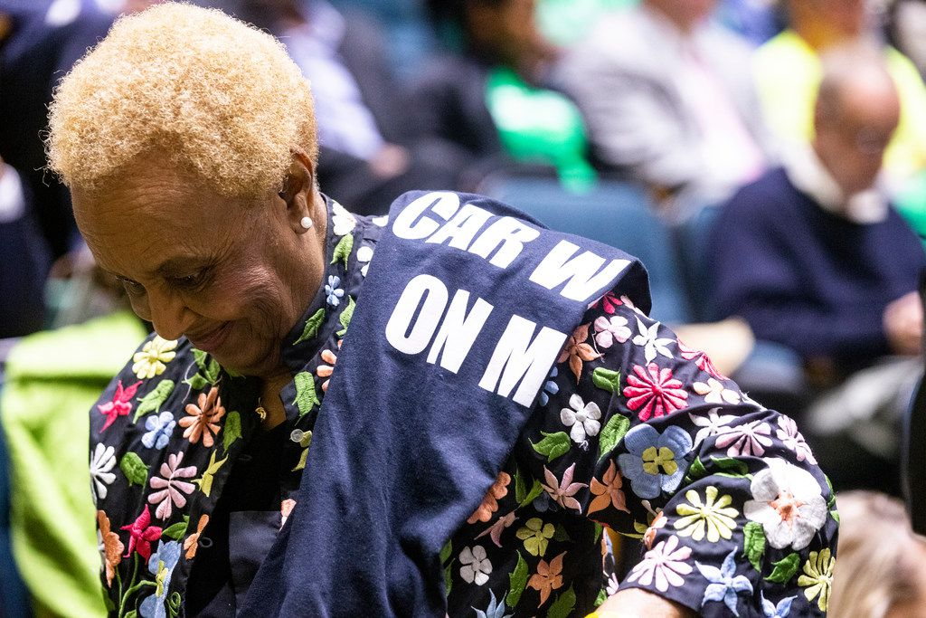 Willie Colman walks back to her seat after speaking against Jim's Car Wash to the council members at Dallas City Hall on Wednesday, October 24, 2018. Members of the public gave their comment regarding a resolution requesting the Board of Adjustment to authorize compliance proceedings for Jim's Car Wash. (Shaban Athuman/The Dallas Morning News)