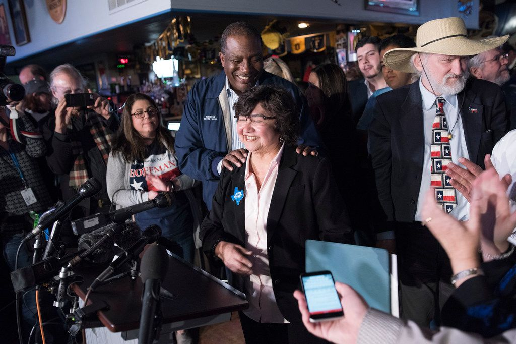 Gubernatorial Candidate Lupe Valdez and State Senator Royce West leave the podium during a watching party at the Dallasite on Tuesday, March 6, 2018.