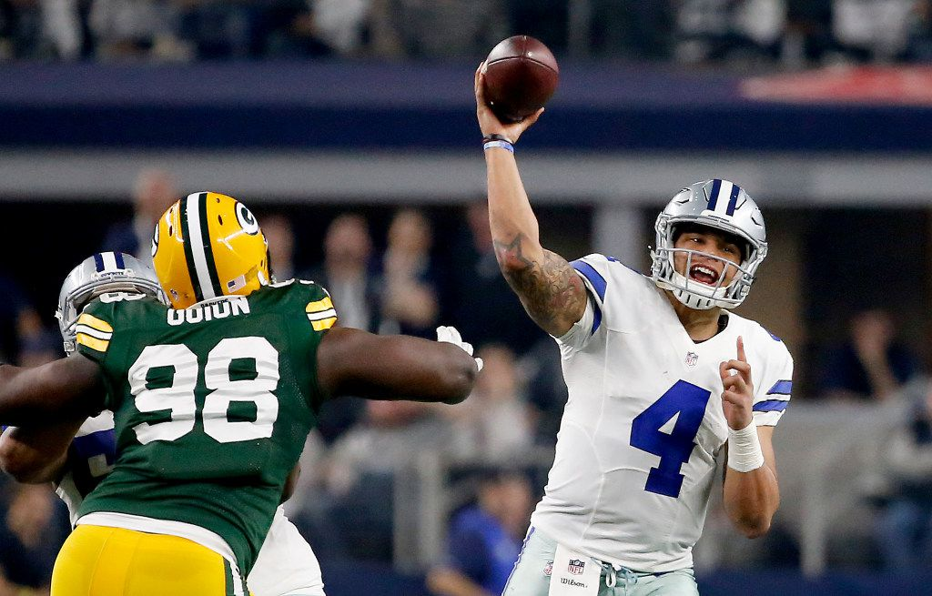 Dallas Cowboys quarterback Dak Prescott (4) throws the ball downfield over Green Bay Packers defensive end Letroy Guion (98) during the fourth quarter at AT&T Stadium in Arlington, Texas, Sunday, Jan. 15, 2017. The Dallas Cowboys lost 34-31. (Jae S. Lee/The Dallas Morning News)