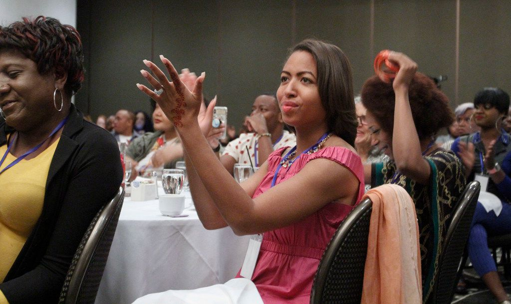 Jade Lenore applauds keynote speaker Jonathan Thunderword at the Black Trans Advocacy Conference in Dallas.
