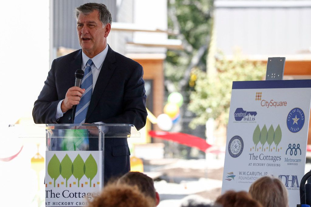 Dallas Mayor Mike Rawlings spoke on stage during the opening ceremony at Cottages at Hickory Crossing on Sept. 8, 2016 in Dallas. The 50 small housing units built by CitySquare opens after more than a year of delays. These housing units are for housing the most expensive chronically homeless people in Dallas.