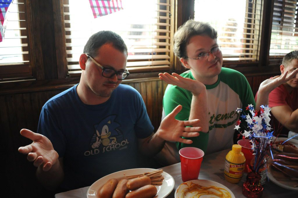 The Nolan brothers try their best at the 7th annual Brass Knuckles Corn Dog Beatdown at The Libertine Bar on July 4, 2015.