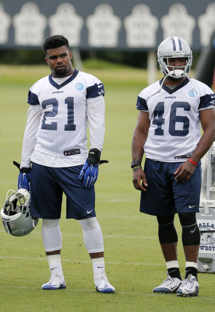 Dallas Cowboys running backs Ezekiel Elliott (21) and Alfred Morris (46) watch the as the team runs drills during an NFL football training camp, Wednesday, June 1, 2016, in Irving, Texas. (AP Photo/Tony Gutierrez)