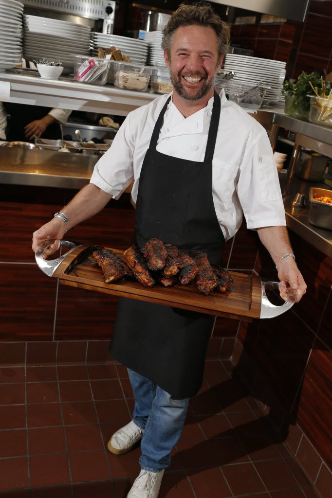 Chef Nick Badovinus with wood-fired meats in 2015