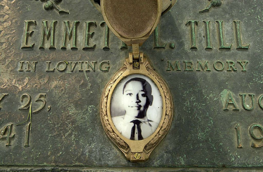 """Emmett Till's photo adorns his grave marker  in Alsip, Ill. His mother insisted that he have an open-casket funeral because she wanted """"the world to see this."""" (2005 File Photo/Chicago Sun-Times)"""