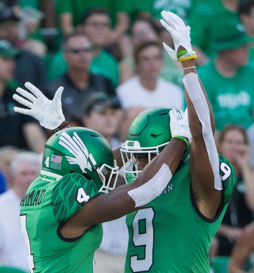 North Texas Mean Green running back Anthony Wyche (4) and North Texas Mean Green wide receiver Jalen Guyton (9) celebrate a play during a game between University of North Texas and Southern Methodist University on Saturday, September 1, 2018 at Apogee Stadium in Denton, Texas. (Ryan Michalesko/The Dallas Morning News)