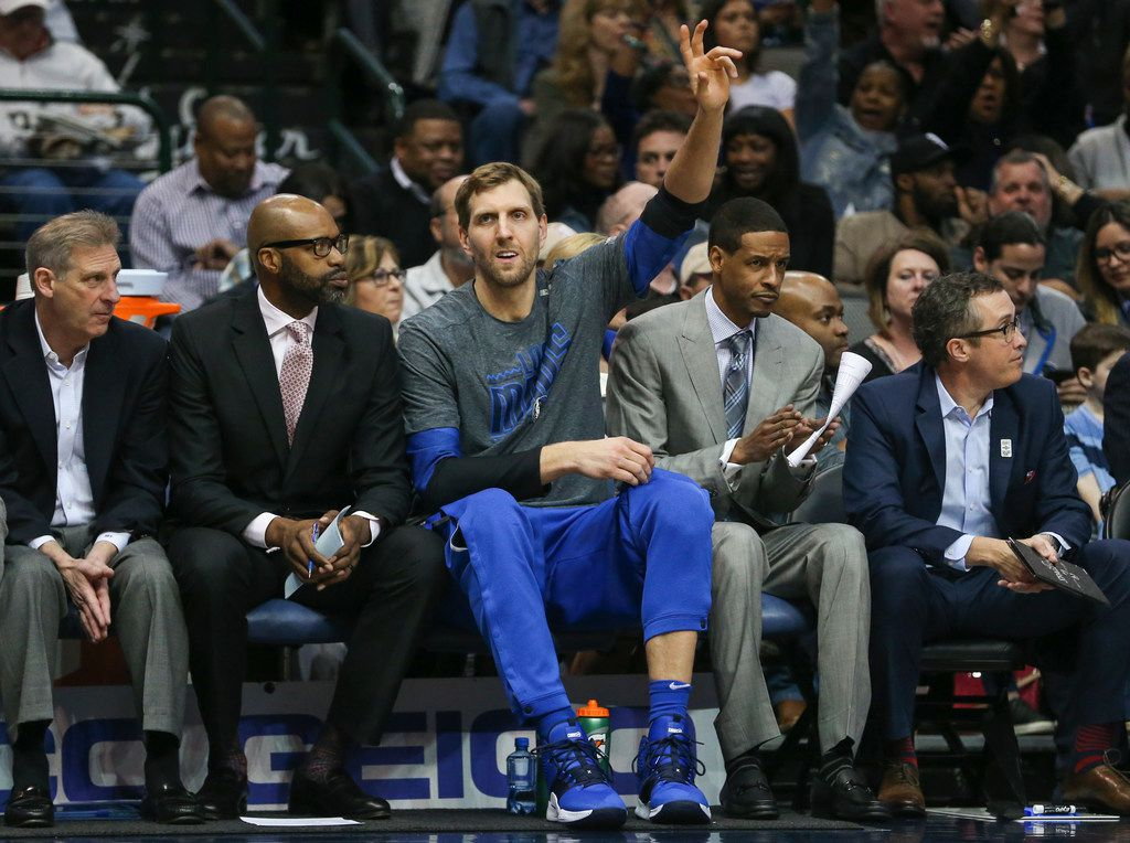 Dallas Mavericks forward Dirk Nowitzki (41) waves from the bench during the first half of a matchup between the Dallas Mavericks and the Houston Rockets on Sunday, March 10, 2019 at the American Airlines Center in Dallas. (Ryan Michalesko/The Dallas Morning News)
