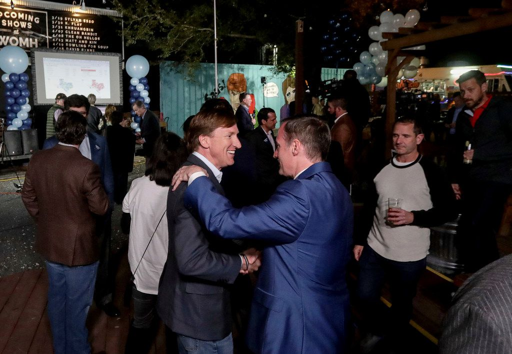 Andrew White (front left) a Democratic candidate for governor, greets Beau Miller during an election watch party at Raven Tower in Houston on Tuesday, March 6, 2018.