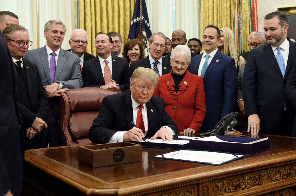 President Donald Trump signed criminal justice overhaul measures in the Oval Office on December 21, 2018. At right, in beard, is Sen. Ted Cruz.  Photo by Olivier Douliery/ Abaca Press