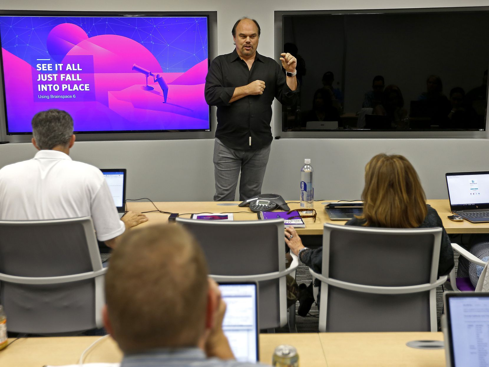 Dave Copps, CEO and founder of Brainspace, a Cyxtera business, speaks during a training class at the Addison, Texas, office on Tuesday, Oct. 10, 2017.
