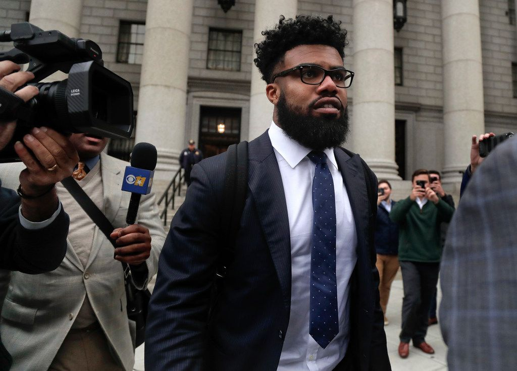 Dallas Cowboys NFL football star Ezekiel Elliott walks out of federal court, Thursday, Nov. 9, 2017, in New York. Elliott's lawyers argued before a Manhattan federal appeals court on whether the Cowboys running back should be allowed to play while three judges decide the fate of his six-game suspension for alleged domestic violence.