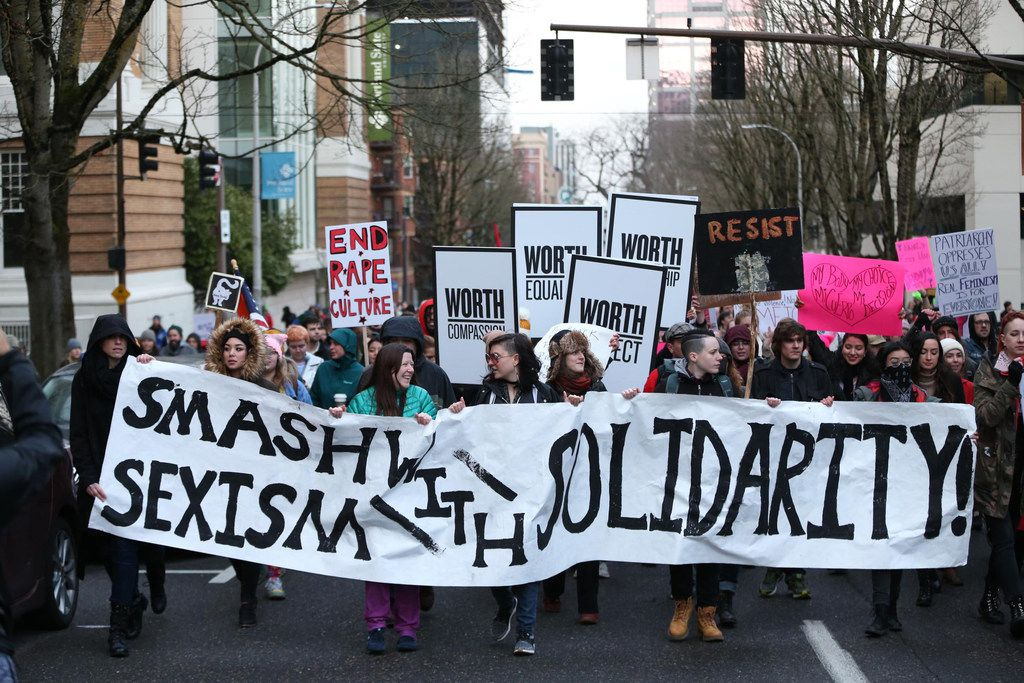 People march in support of female empowerment and women's rights Jan. 20, 2018, in Portland, Ore. Participants in the #MeToo March gathered at Pioneer Courthouse Square. Demonstrators from Los Angeles to New York marched in support of female empowerment and denounced President Donald Trump's views on immigration, abortion, LGBT rights and women's rights on Saturday, the anniversary of his inauguration. (Dave Killen/The Oregonian)